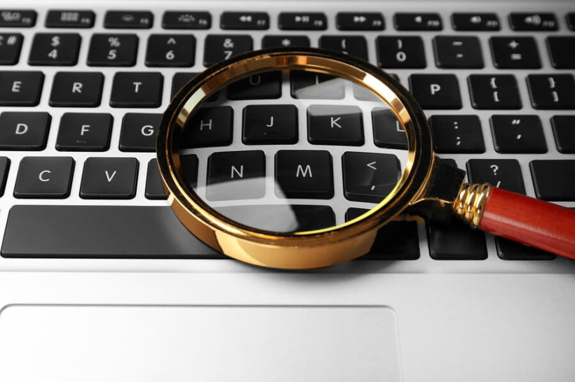 bigstock Magnifying glass on laptop In 205917784